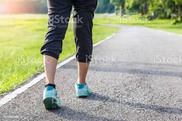 Closeup of female shoe runner feet running on road with nature picture id701263280?b=1&k=6&m=701263280&s=612x612&h=oegnmfbbdgixsvqp pojnwqiq2by9jar9j6crzsyu9w=