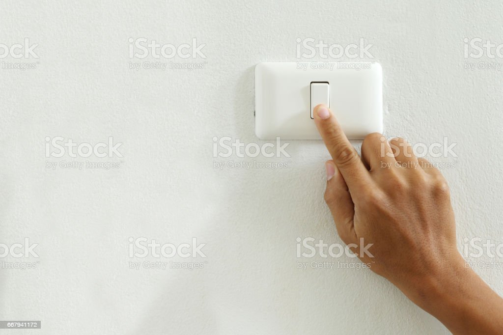 closeup of finger touching to electric switch off with copy space stock photo