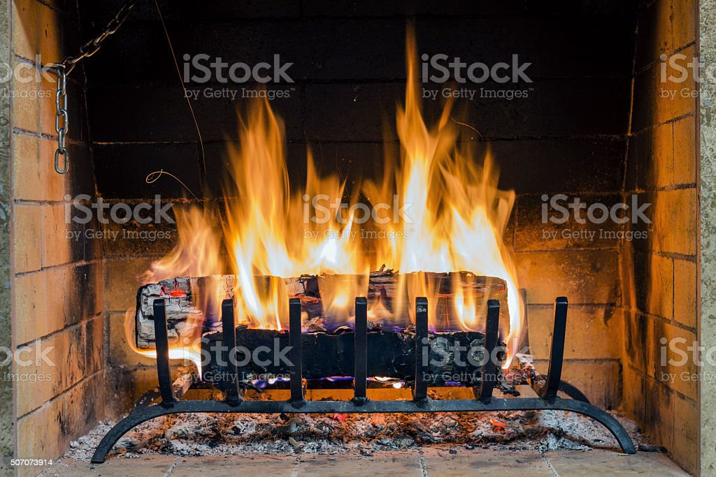 Closeup of firewood burning in fire. stock photo