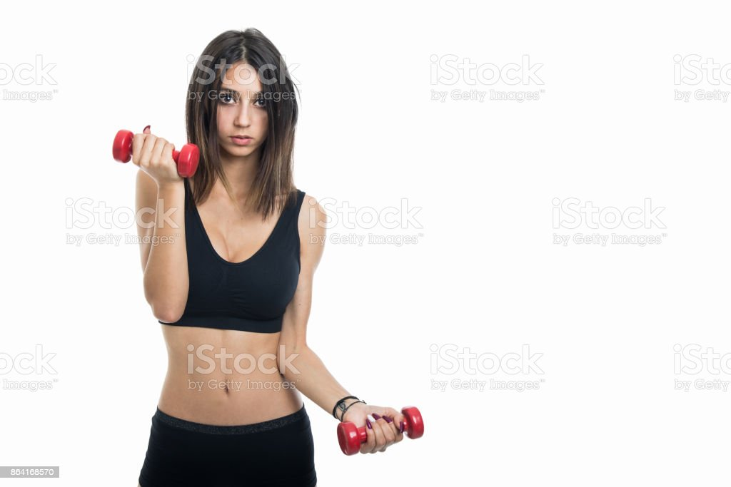 Close-up of fit girl exercising with two dumbbells royalty-free stock photo