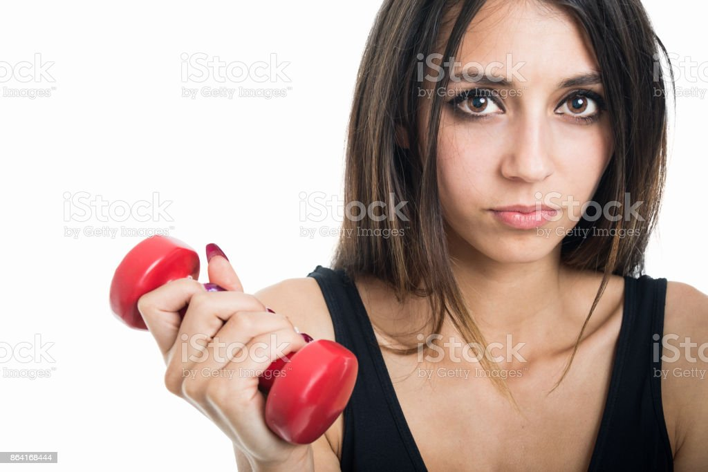 Close-up of fit girl holding red dumbbell royalty-free stock photo