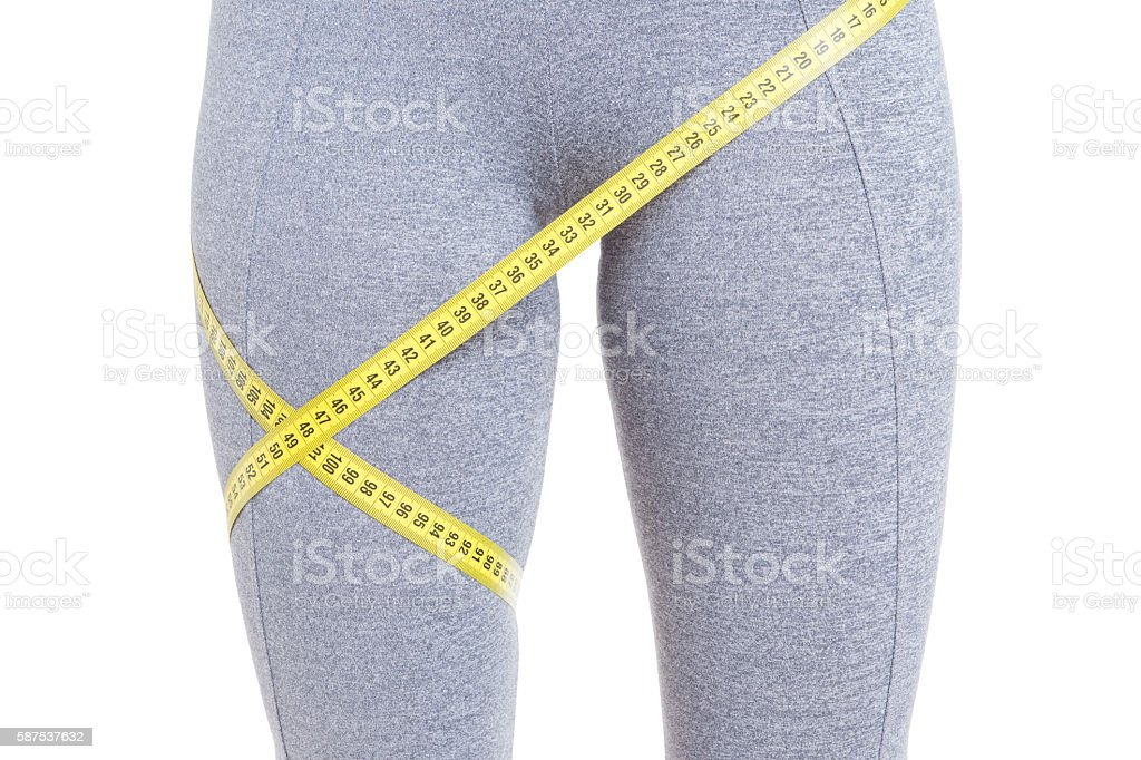 Close-up of fit legs with measured by tape line stock photo