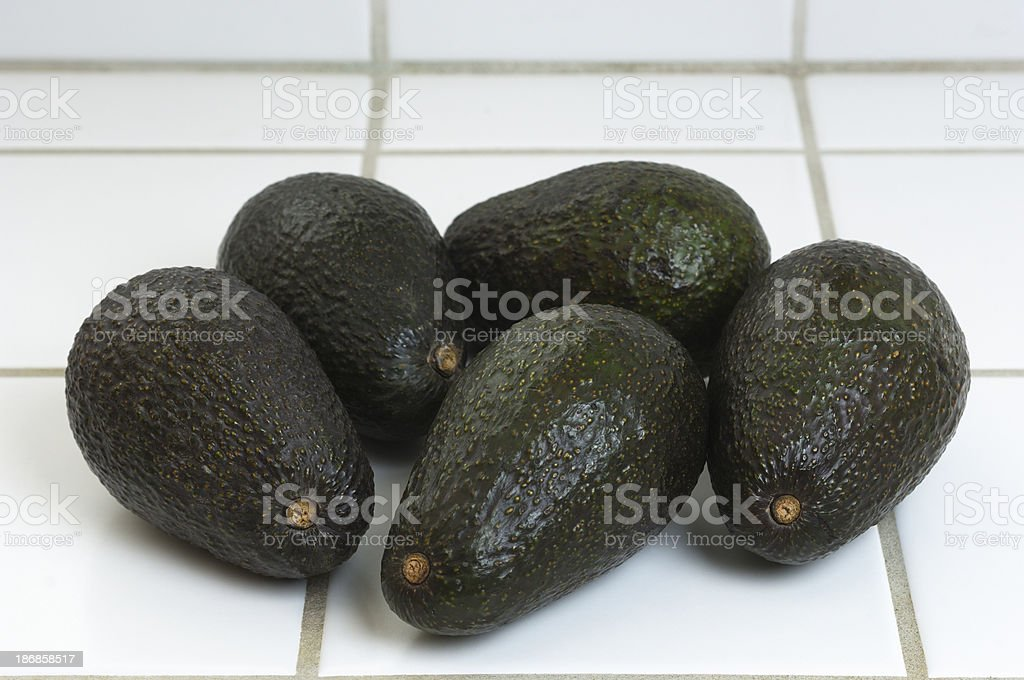 Close-up of Five Avacados on Kitchen Counter stock photo