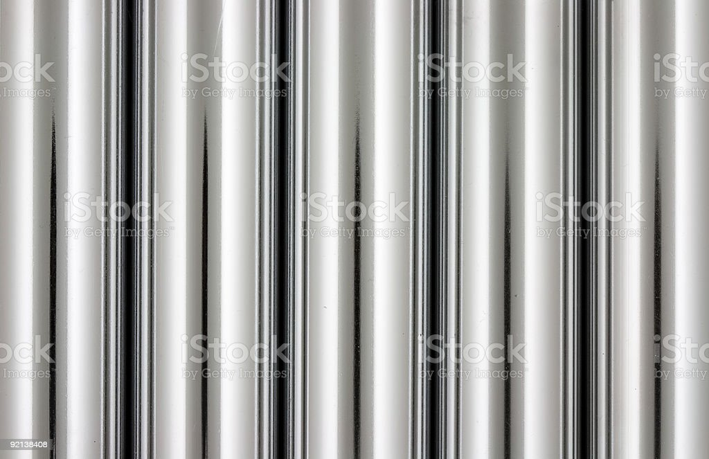 Close-up of five chrome pipes background stock photo