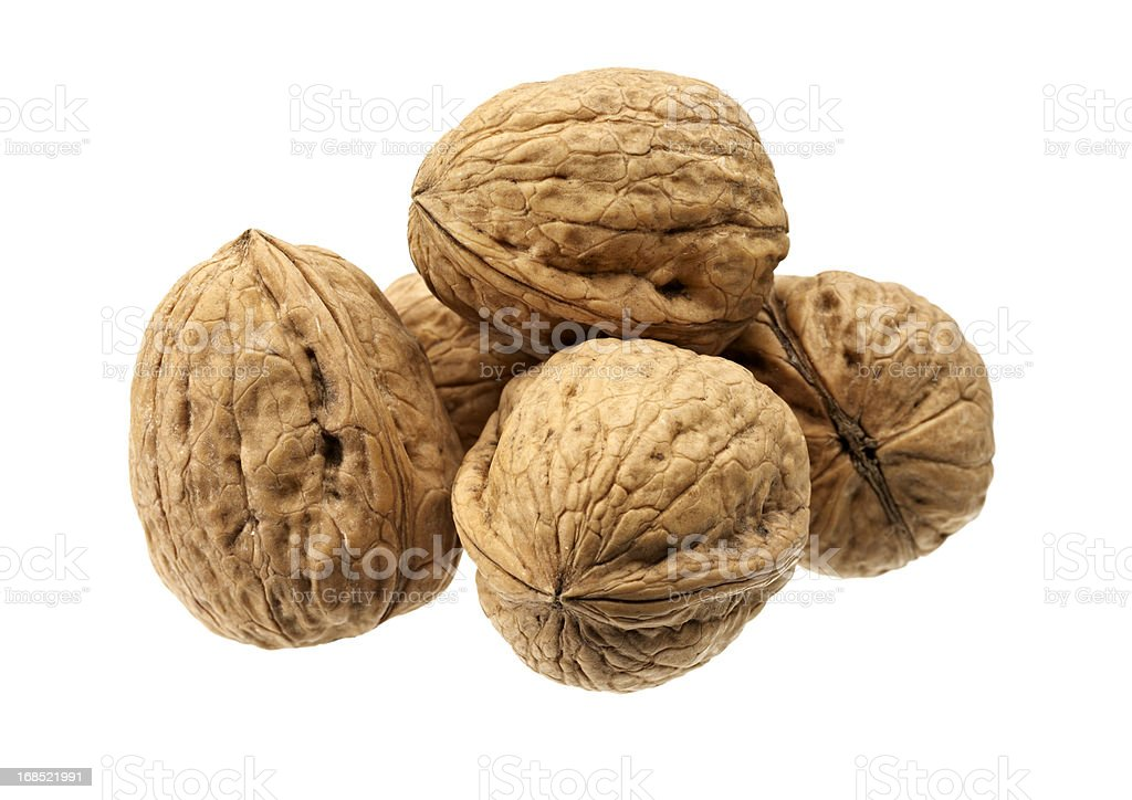 Close-up of five shelled walnuts over a white background stock photo