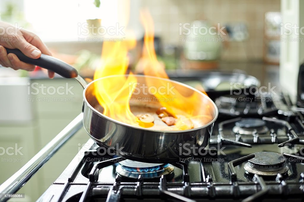 Close-up of flames in frying pan stock photo