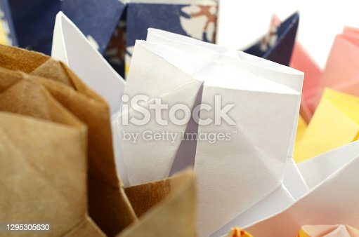 Closeup of folded paper boats background