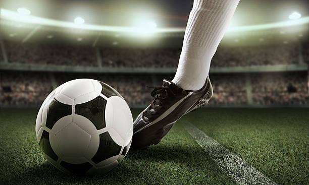 close-up of foot near soccer ball - internationaal voetbalevenement stockfoto's en -beelden