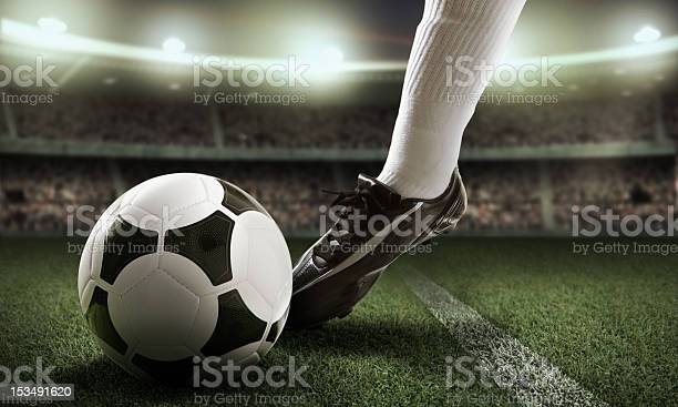 Closeup Of Foot Near Soccer Ball Stock Photo - Download Image Now