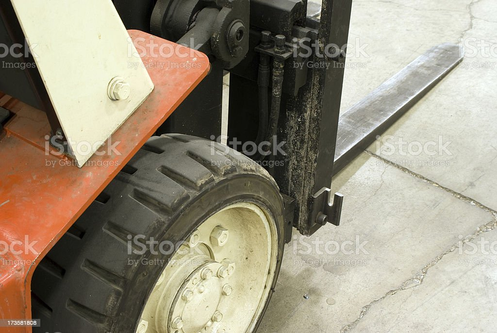 close-up of forklift on concrete floor royalty-free stock photo