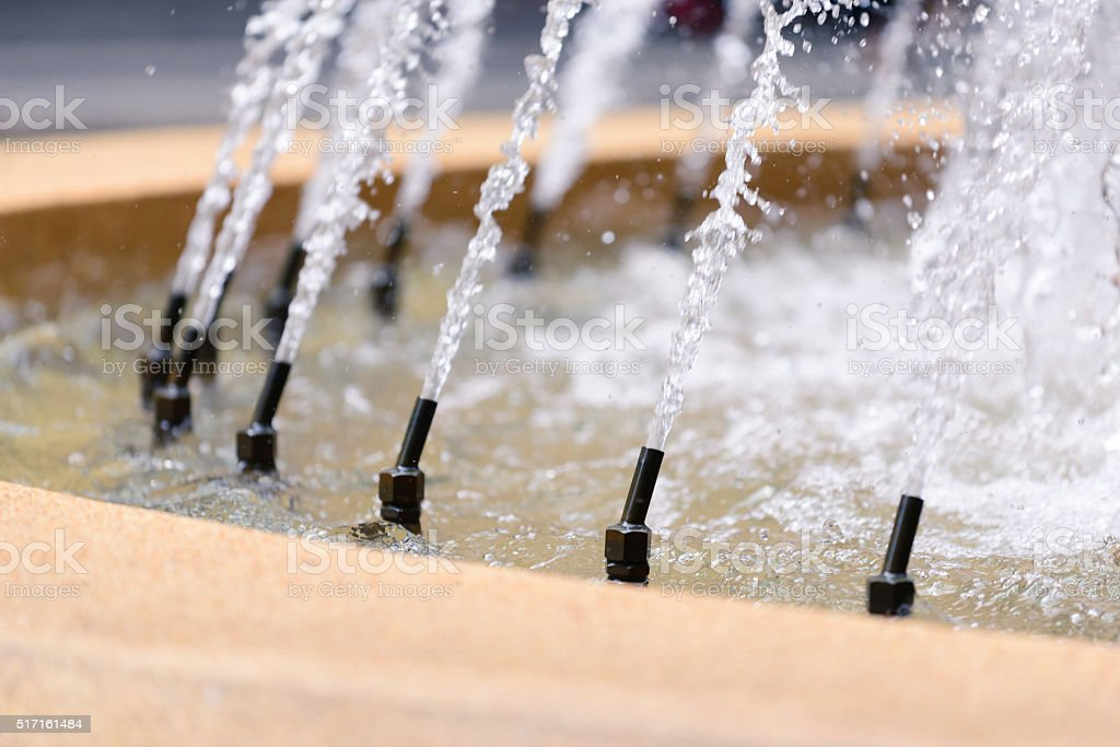 Closeup of fountain system in garden, selective focused. stock photo