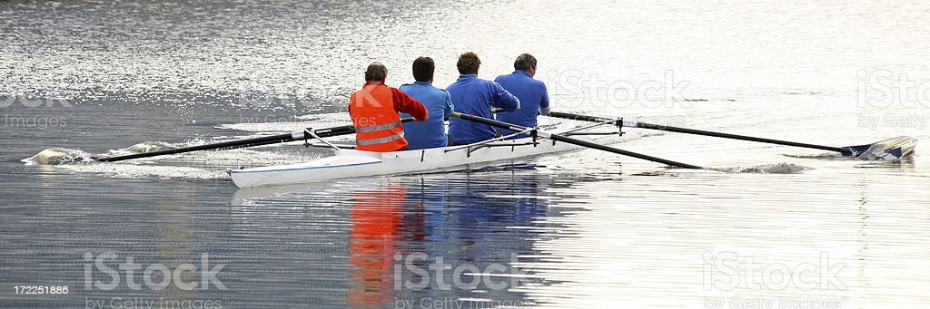 Close-up of four men rowing in a canal royalty-free stock photo