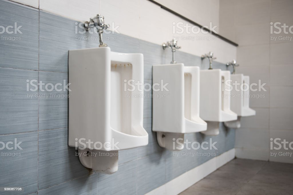 Closeup Of Four White Urinals In Menu0027s Bathroom, Design Of White Ceramic  Urinals For Men