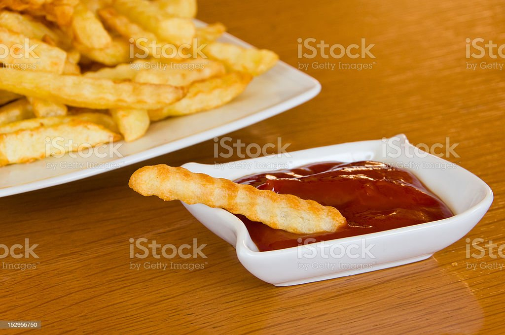 Close-up of french fry in ketchup stock photo