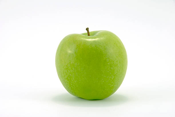 Close-up of fresh Granny Smith apple Granny Smith Apple on white background granny smith apple stock pictures, royalty-free photos & images