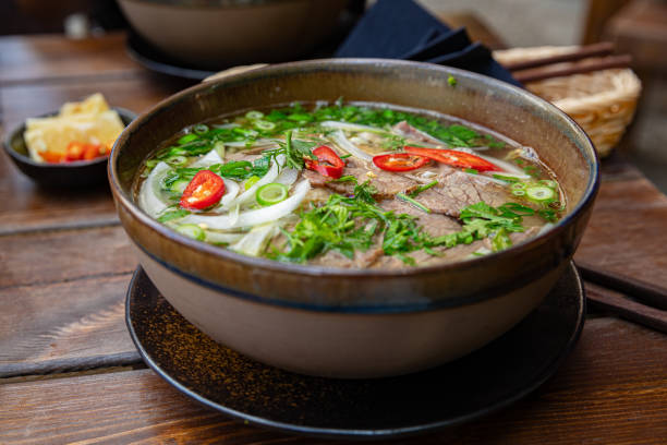 Close-up of fresh Pho soup in bowl served on table stock photo