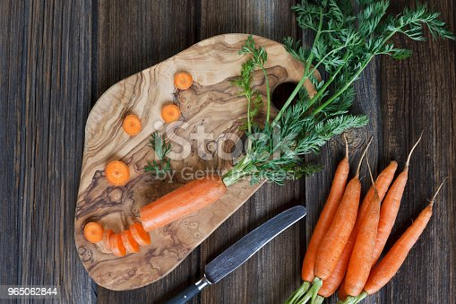 Closeup Of Fresh Raw Carrot On Wooden Board With Knife Top View On Rustic Wooden Background Stock Photo & More Pictures of Agriculture