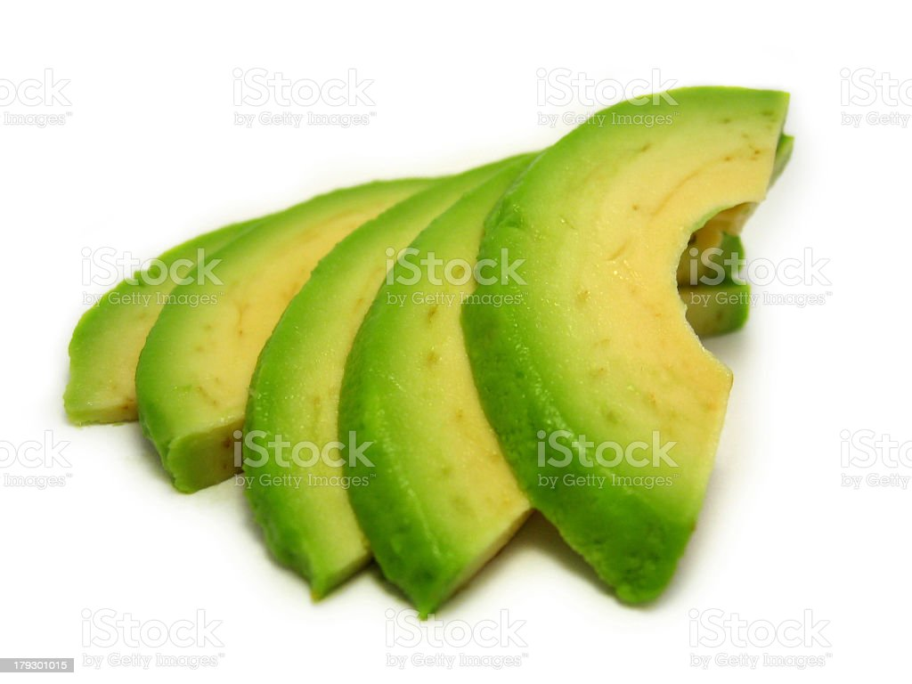 Close-up of fresh ripe avocado slices on white background stock photo