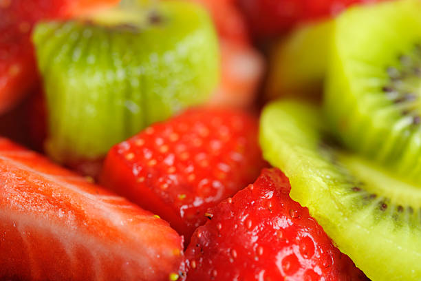 Close-Up of Fresh Strawberries and Kiwi Fruit in syrup stock photo