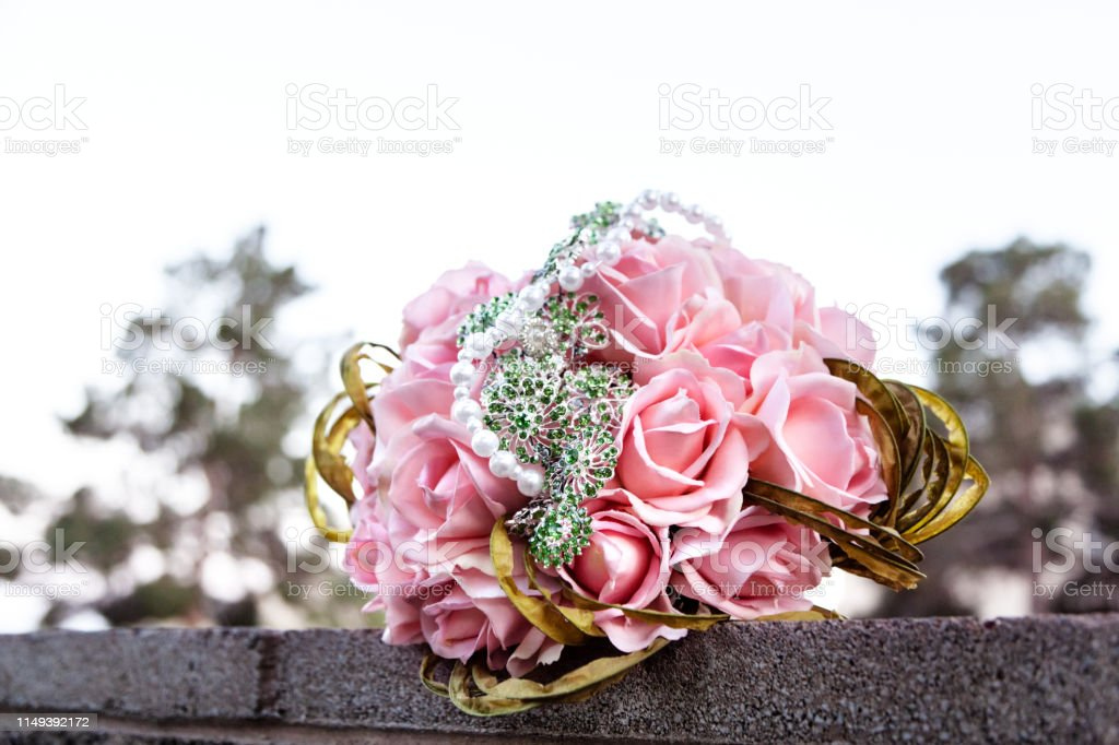 Closeup of fresh wedding flowers with pink roses outdoor on wedding day stock photo
