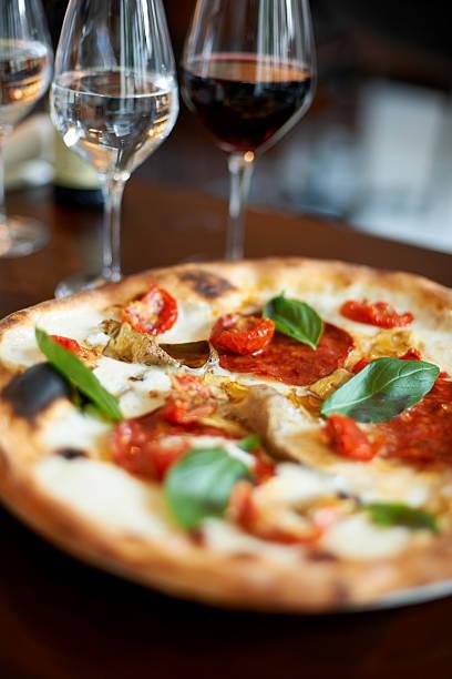 Closeup of freshly baked pizza at restaurant stock photo