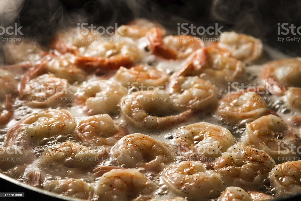 Closeup of fried shrimps in butter on a frying pan stock photo