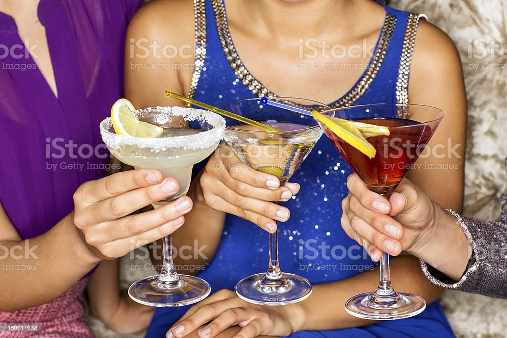 Close-Up Of Friends Holding Cocktail Drinks At Nightclub stock photo