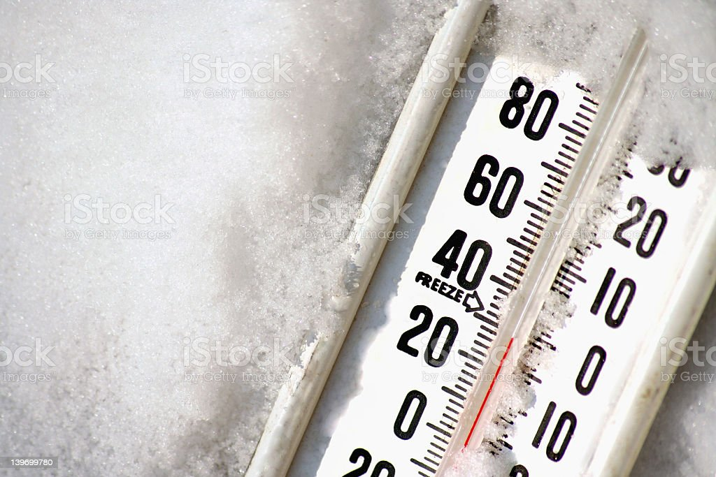 Close-up of frozen thermometer at 30 degrees Fahrenheit stock photo