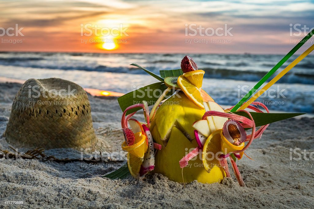 Closeup of fruit cocktail on the beach at sunset royalty-free stock photo