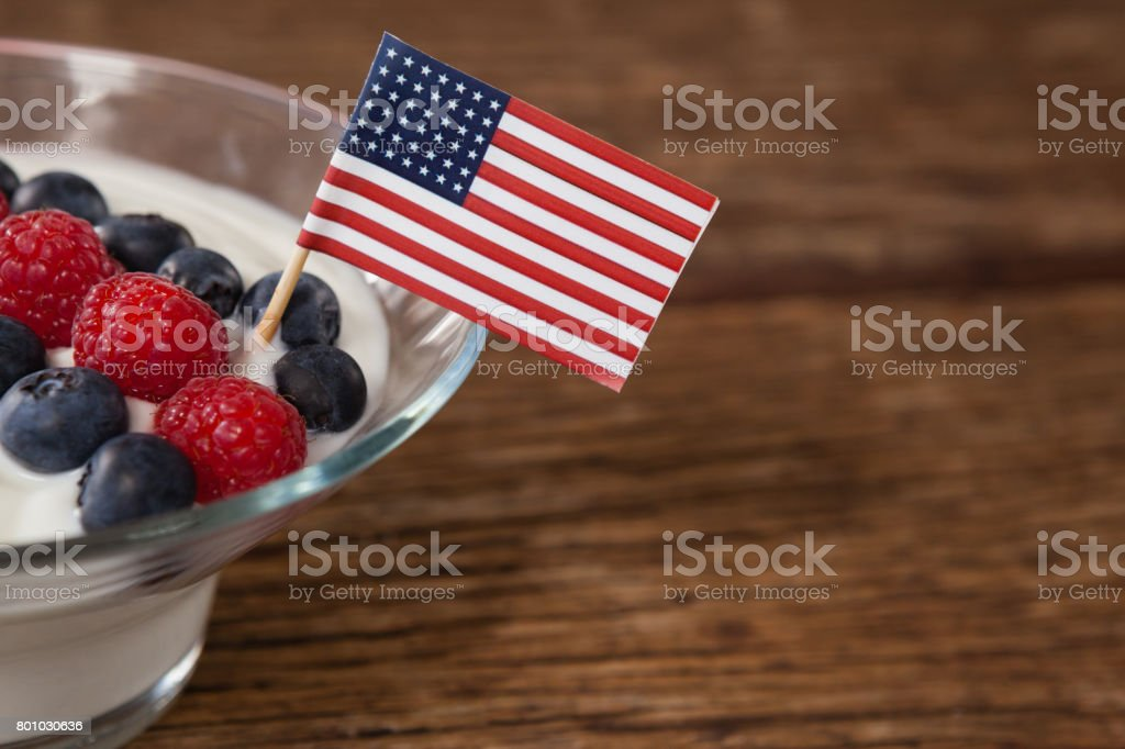 Close-up of fruit ice cream decorated with 4th july theme stock photo