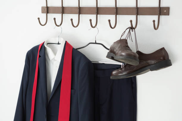 Close-up of full suit and shoes hanging on hook stock photo