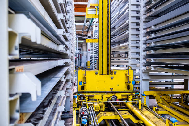 close-up of fully automated warehouse system - metal robot in logistic factory foto e immagini stock