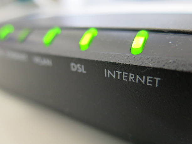 close-up of functioning internet modem - spetsig vinkel bildbanksfoton och bilder