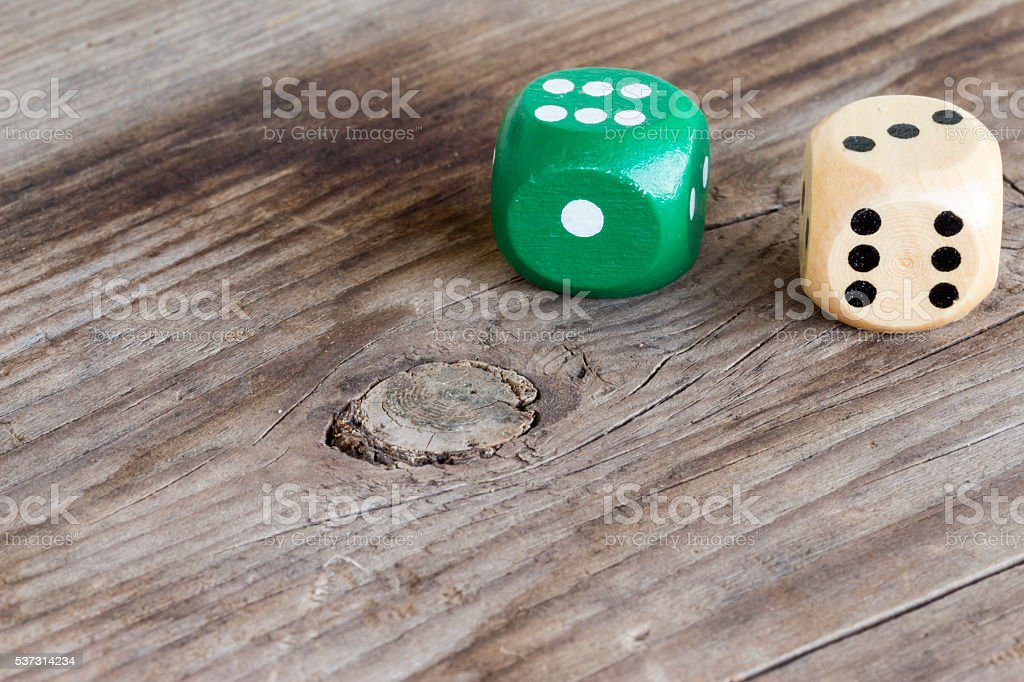 close-up of gaming dice on wooden background stock photo