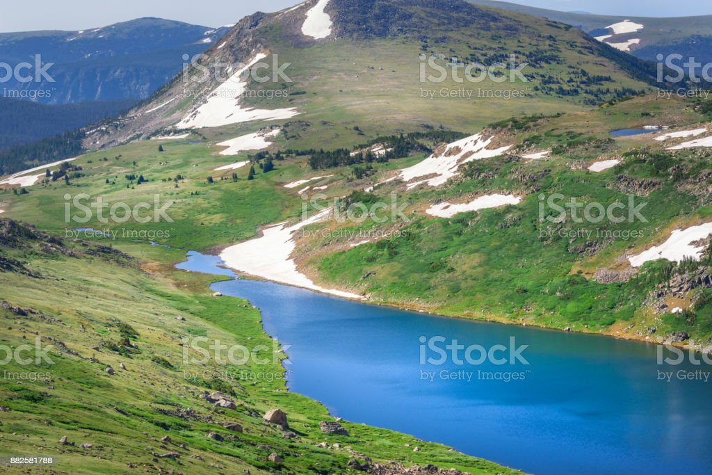 Closeup of Gardner Lake, Beartooth Pass. Peaks of Beartooth Mountains, Shoshone National Forest, Wyoming, USA. stock photo