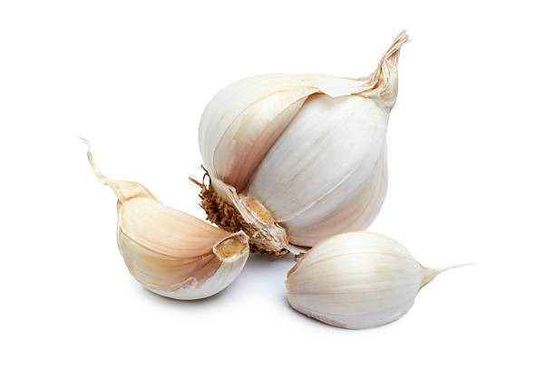 Close-up of garlic clove on white background stock photo