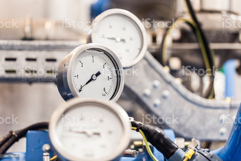 Close-up of gauges on machinery in industry stock photo