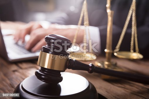 istock Close-up Of Gavel And Justice Scale 949199590