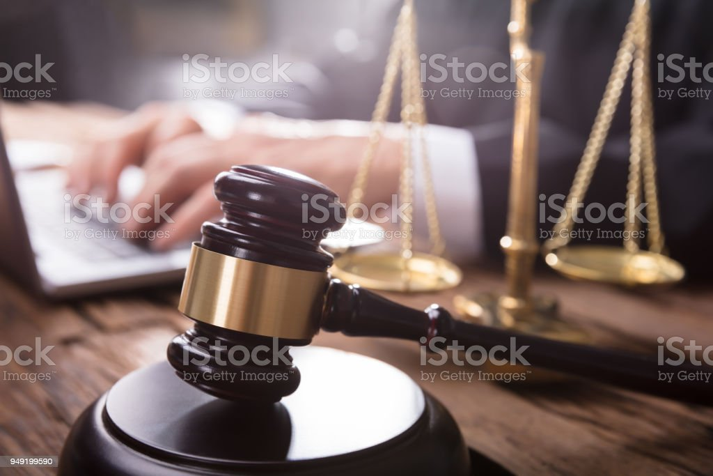 Close-up Of Gavel And Justice Scale stock photo