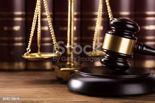 istock Close-up Of Gavel On Wooden Desk 949210678