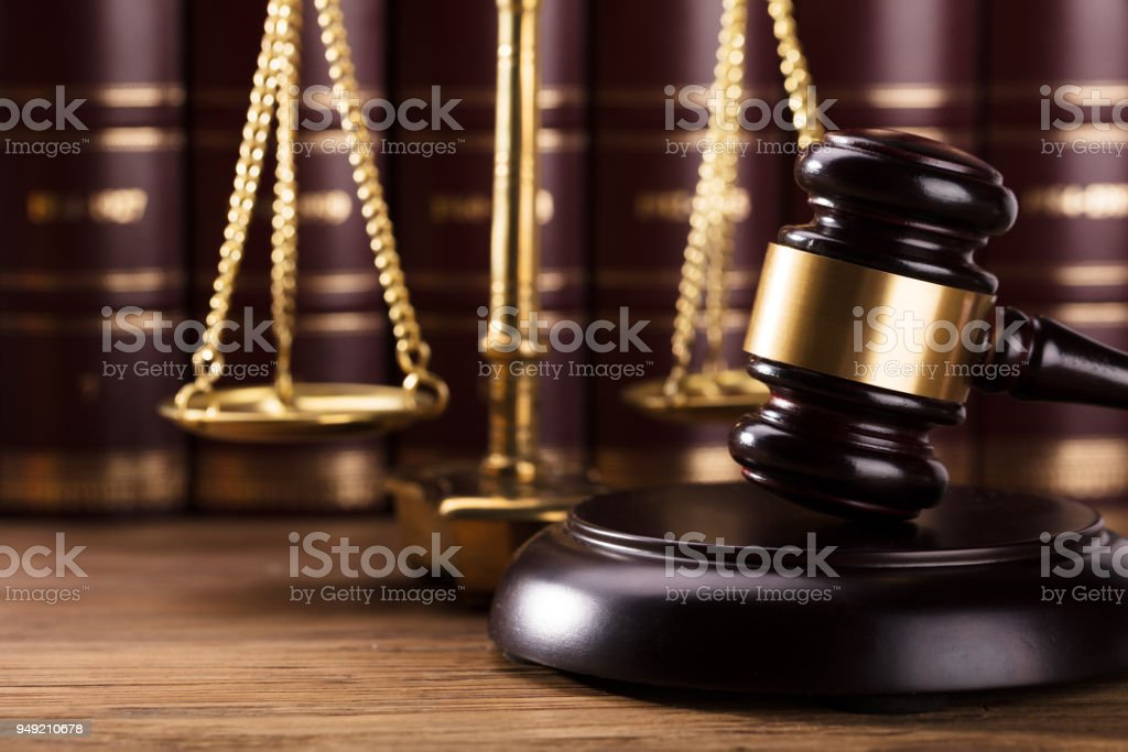 Close-up Of Gavel On Wooden Desk stock photo