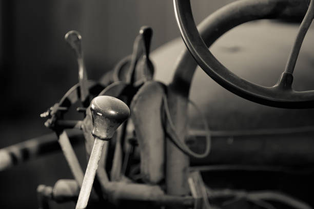 Closeup of gear shift and wheel on an antique farm tractor stock photo