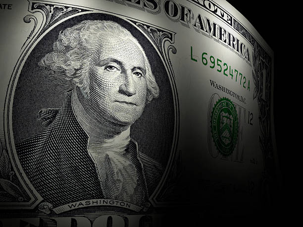 Close-up of George Washington on a dollar bill One dollar bill with sharp focus and selective lights low scale magnification stock pictures, royalty-free photos & images