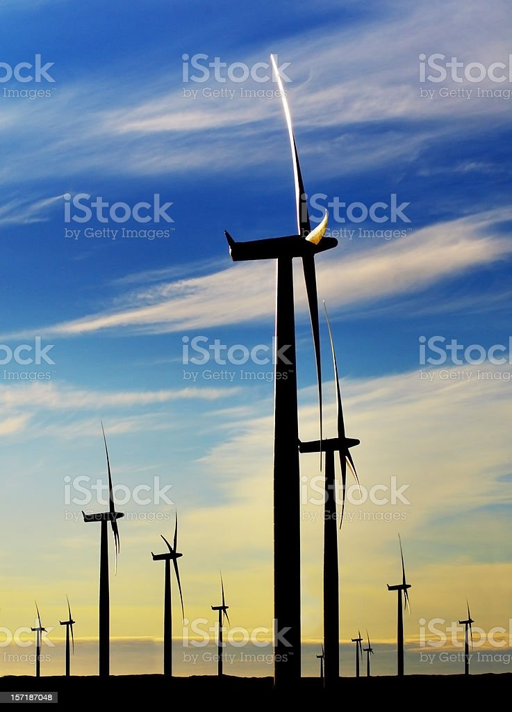 Close-up of giant wind turbines producing renewable energy royalty-free stock photo