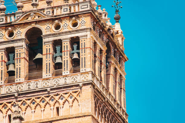 Close-up of Giralda tower in Seville A close-up of Giralda tower in Seville, Spain. santa cruz seville stock pictures, royalty-free photos & images