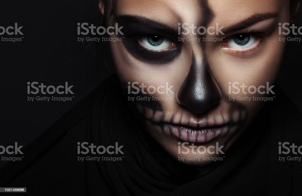 Close-up of girl face with make-up skeleton. Halloween portrait. stock photo