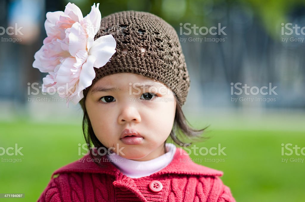 Closeup of girl in flower hat royalty-free stock photo