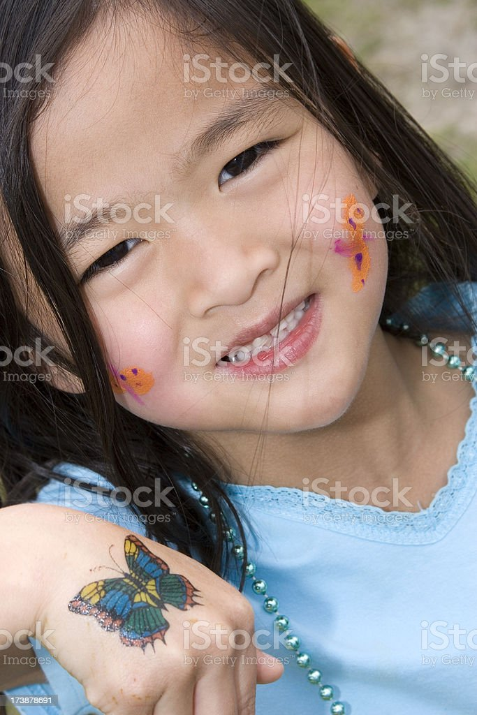Closeup of girl with face painted and tattoo royalty-free stock photo