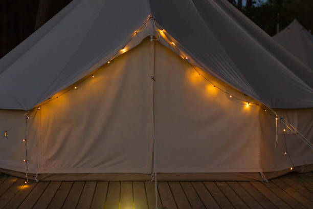 Close-up of glamping bell tent at night stock photo