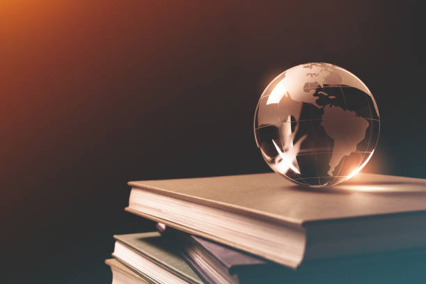 Close-up of Glass Globe on a Stack of Books stock photo